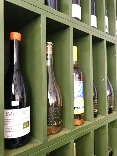 Pas que tapas ! Container Bottle Drink No People Indoors  Text Glass - Material Food And Drink Green Color Wine Bottle Shelf