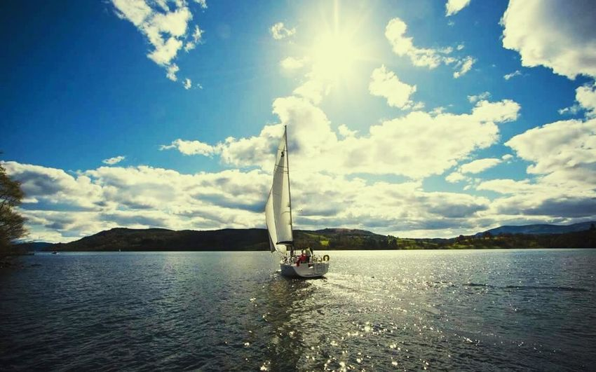 Boat Sky Nautical Vessel Sunlight Water Transportation Mountain Tranquility Waterfront Tranquil Scene Scenics Cloud - Sky Mode Of Transport Nature Sailboat Beauty In Nature Sunbeam Mountain Range Bright Day @suckeraphy @emreuste