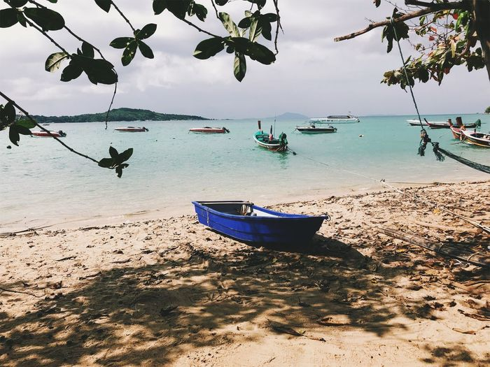 Anchored Beach Beauty In Nature Day Horizon Over Water Land Mode Of Transportation Moored Nature Nautical Vessel No People Outdoors Plant Sand Scenics - Nature Sea Sky Tranquility Transportation Tree Water