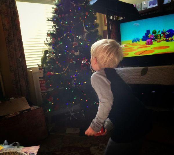 Sam's about to throw a cloth block in the air (& perhaps catch it; not necessary to the success of the game). Childhood Christmas Kids Real People Vintage Christmas Indoors  Child Window Christmas Home Interior Christmas Decoration Elementary Age Little Boy Kids Living Room One Person Blond Hair Domestic Life Christmastime Christmas Tree Boy Throwing Television Home Interior Christmas Lights Christmas Spirit Boy With Christmas Tree