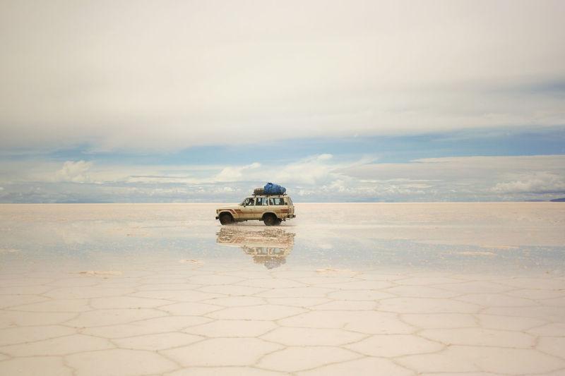 Vehicle With Reflection At Salar De Uyuni