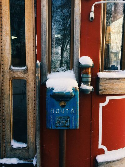Snow on mailbox outside house