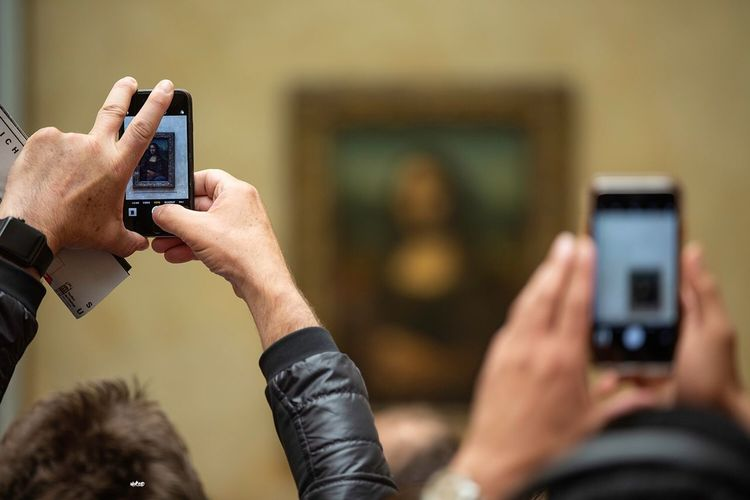 Most famous woman Paris Louvre Monalisa_gallary Paint EyeEm Best Shots Photooftheday Photography Picture Smart Phone Photographing Activity Wireless Technology Mobile Phone People Camera