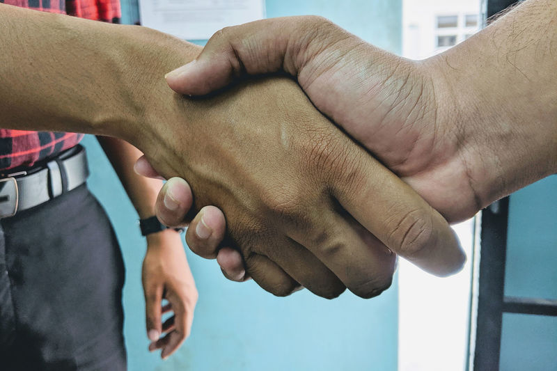 Midsection of man shaking hands