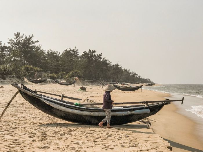 Shore Walking Forest Beach Vietnamese Fisherman Boat Boats Boat Fisherman One Woman Only Old Woman Conical Hat Sky Water Beach Land Sea Clear Sky Nautical Vessel Nature Sand Tree Beauty In Nature Mode Of Transportation Tranquility Scenics - Nature Transportation Plant Incidental People Outdoors