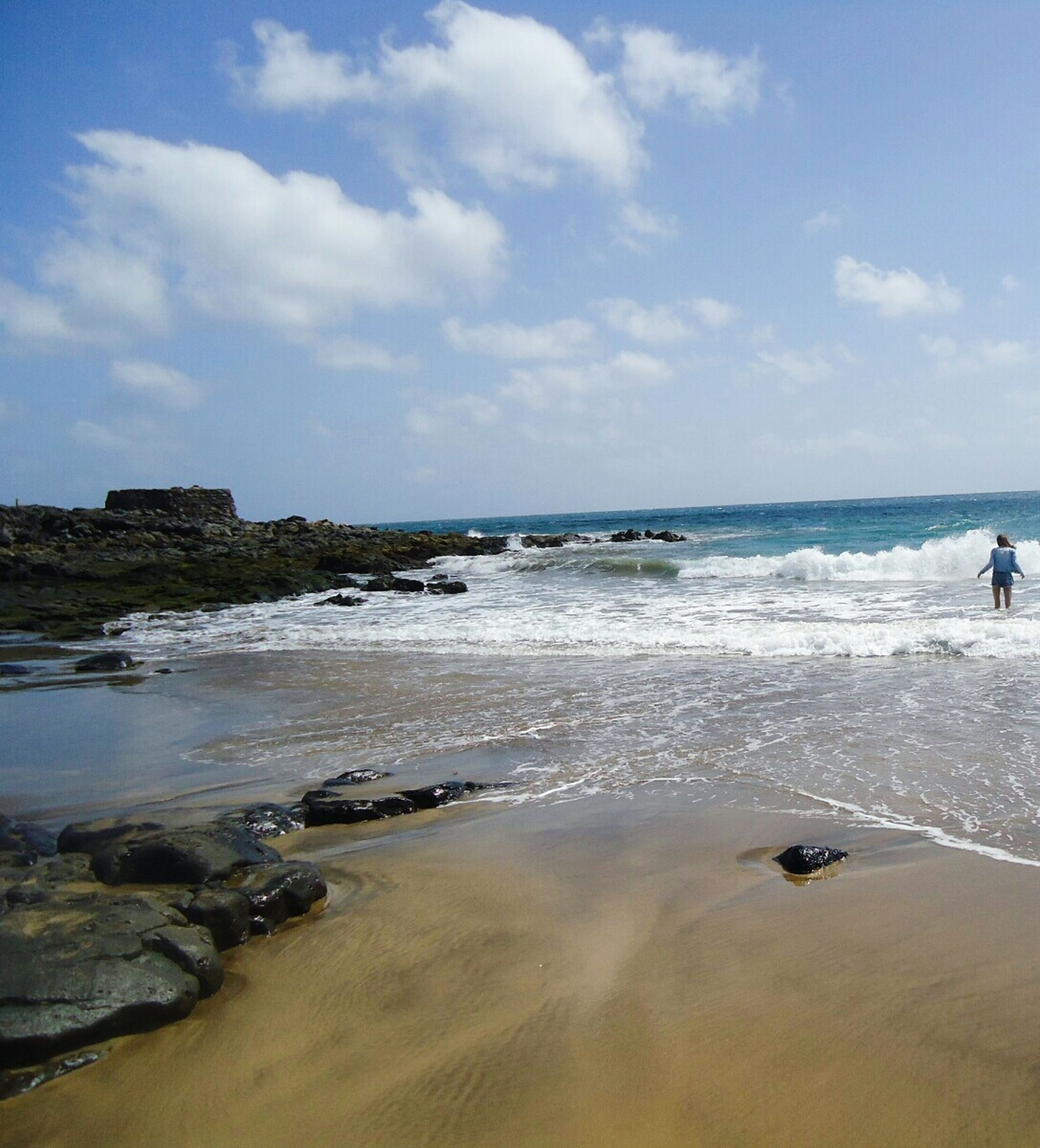 sea, water, beach, horizon over water, sky, wave, shore, scenics, beauty in nature, surf, cloud - sky, tranquil scene, nature, tranquility, sand, cloud, rock - object, motion, idyllic