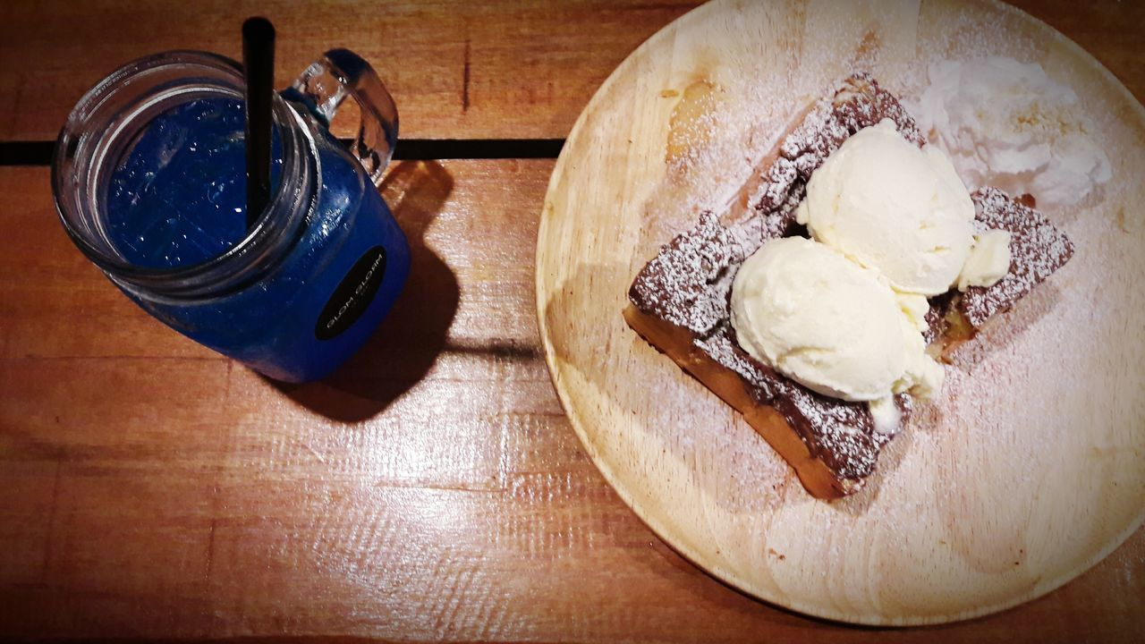 food and drink, sweet food, table, still life, dessert, high angle view, freshness, indoors, indulgence, food, directly above, no people, ready-to-eat, temptation, unhealthy eating, ice cream, close-up, frozen food, day