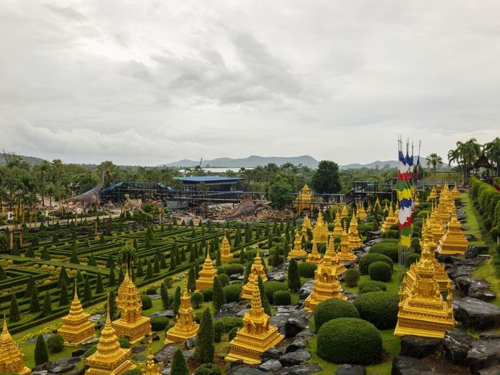 Nong Nooch Garden Nong Nooch Tropical Bothanical Garden Plant Cloud - Sky Flower Sky Flowering Plant Beauty In Nature Nature Flowerbed Freshness Landscape Built Structure Day Architecture No People Yellow Garden Environment Growth Multi Colored Building Exterior