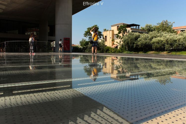 Acropolis museum greece. AcropolisMuseum Architecture Blue Building City City Life Day House Low Angle View Olive Tree Reflection Sky Travel Destinations