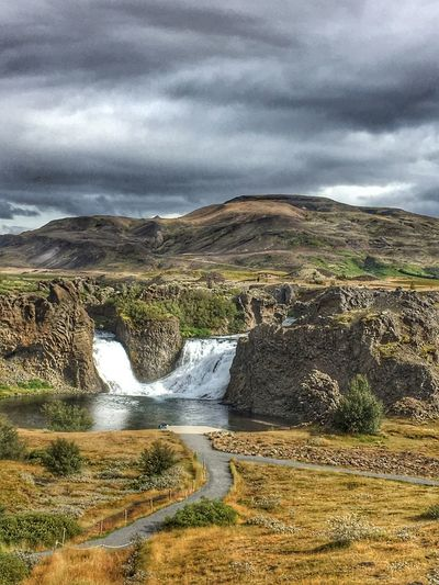 Beauty In Nature Nature Scenics Water Sky Cloud - Sky Waterfall Outdoors Idyllic Tranquility No People Tranquil Scene Motion Landscape Day Mountain Grass Power In Nature Iceland