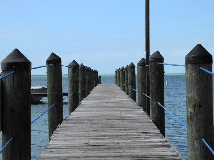 Taken by Leonidas Bratini B Blue Boardwalk Built Structure Clear Sky Diminishing Perspective Horizon Over Water L Narrow Nature Pier Pole Scenics Sea Sky The Way Forward Tourism Tranquil Scene Tranquility Travel Destinations Water Wood - Material Wood Paneling Wooden Wooden Post