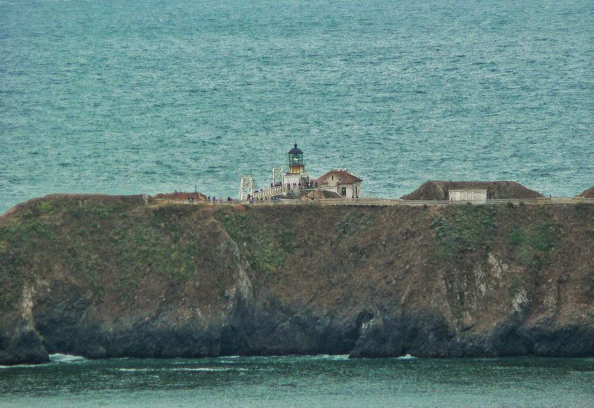 Sea Water Lighthouse Architecture Built Structure Day Building Exterior Nature Rock - Object Travel Destinations Prison No People Outdoors Beauty In Nature Horizon Over Water Wave Marin County CA Point Bonita Lighthouse Beach Rocks And Water