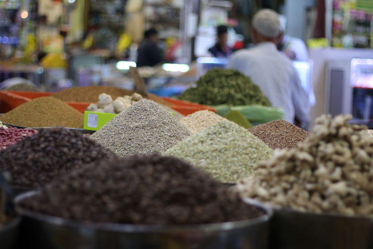 Agadir market Food And Drink Food Market Retail  Market Stall Choice Business Variation Selective Focus Dried Food Freshness Retail Display Store Large Group Of Objects Small Business Abundance Spice Incidental People Container For Sale Indoors  Consumerism
