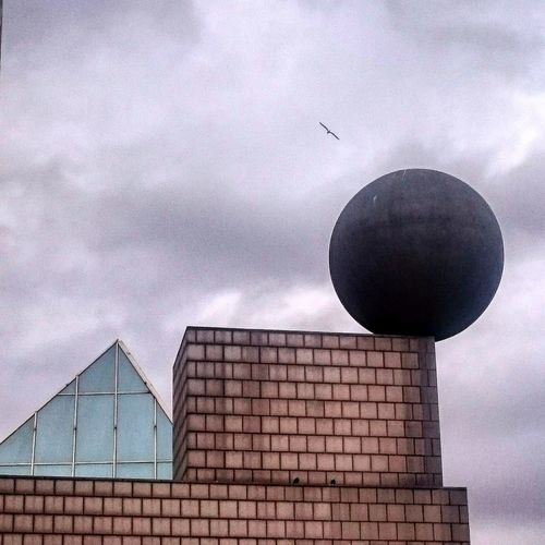 Urban geometry. Urban Geometry Urban Geometry Vila Olimpica Olympic Village Olympic Village Barcelona Catalonia Sky Clouds Clouds And Sky Clouds & Sky Clouds Collection Sky And Clouds Sky & Clouds Sky_collection Building Exterior Building Buildings Triangle Ball Square Bird Flying