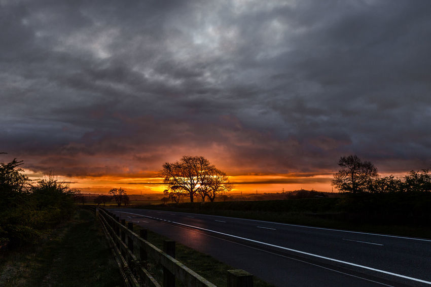 Threatening to Rain Leicestershire, ForebodingClouds Beauty In Nature Cloud - Sky Day Dramatic Sky Foreboding Sky Landscape Nature No People Outdoors Road Scenics Silhouette Sky Storm Cloud Stormy Sunrise Sunrise And Clouds The Way Forward Threatening Clouds Tree Weather