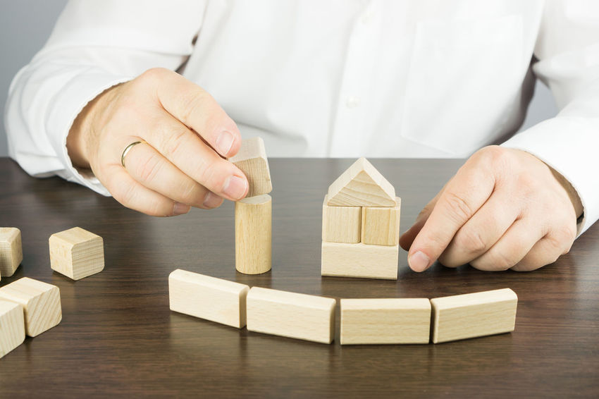 Architecture Construction Homestead Plant Adult Building Building - Activity Close-up Day House House Building Human Hand Indoors  Intelligence Men Model - Object One Person People Skill  Stack Strategy Symbol Toy Toy Block Wood - Material