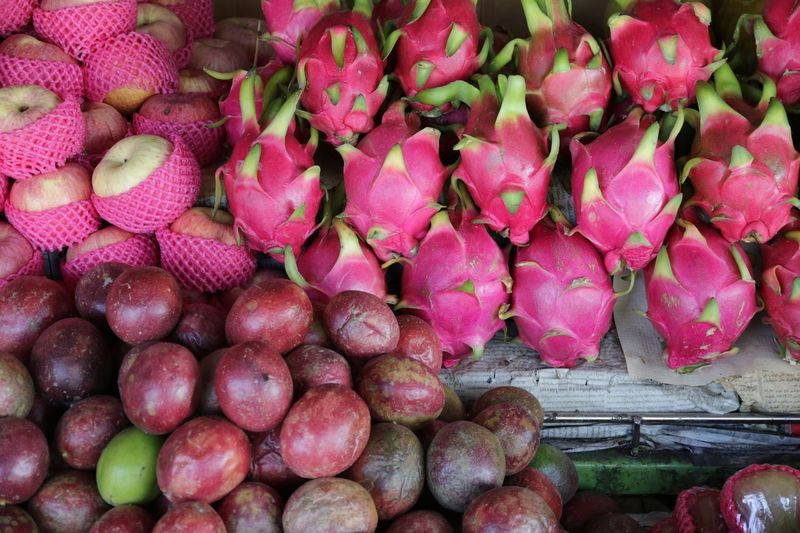 High Angle View Of Pitayas And Apples At Market For Sale