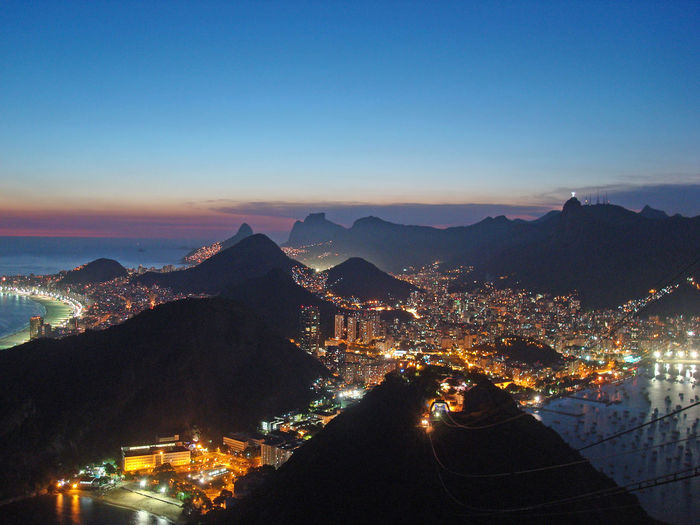 View from Sugar Loaf Mountain in Rio de Janeiro, Brazil at sunset Brazil Lights Rio De Janeiro Sugar Loaf Mountain Architecture Building City Cityscape Clear Sky High Angle View Illuminated Mountain Mountain Range Nature Night Outdoors Sky Sunset TOWNSCAPE