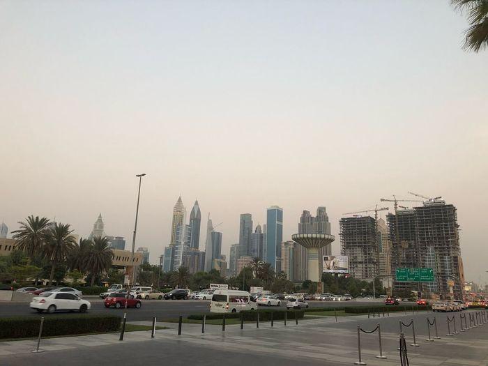 City street and modern buildings against clear sky