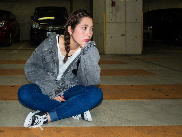 Alone in an underground parking Alone Black Hair ❤❤ Casual Clothing In An Underground Parking Lot Jeans One Person People Portrait Sitting Underground Parking Young Adult Young Eurasian Woman Young Women