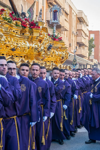 People in the procession in the Holy Week (Semana Santa) in a Spanish city. Malaga, Spain - March 26, 2018. Catolic Church Children Easter Easter Ready Historical Building Holy Week Malaga People Watching SPAIN Semana Santa Spanish Uniform Uniforms Adult Architecture Building Exterior Built Structure Catolicism Celebration City Clothing Crowd Day España Group Of People Large Group Of People Men Musical Instrument Musician Musician Bands Old Buildings Old City Outdoors Procession Real People Religion Spain Is Different Spanish Arquitecture Spanish Culture Standing Togetherness Uniform Women The Great Outdoors - 2018 EyeEm Awards The Traveler - 2018 EyeEm Awards The Street Photographer - 2018 EyeEm Awards