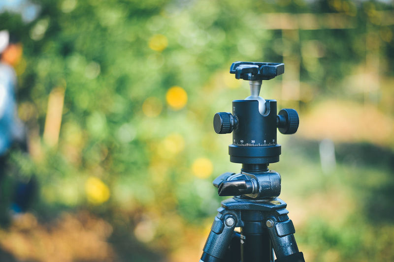 Black Color Camera Camera - Photographic Equipment Close-up Day Digital Camera Focus On Foreground Land Lens - Optical Instrument Machinery Nature No People Outdoors Photographic Equipment Photography Themes Plant Sunlight Technology Tree Tripod