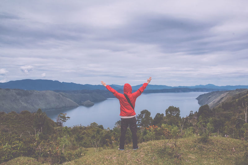man standing on hill looking at the lake toba Field Freedom Retro Toba Tourist Travel Arms Outstretched Arms Raised Beauty In Nature Day Forest Full Length Hand Raised Happiness Hiker Hill Lake Leisure Activity Lifestyles Meadow Men Mountain Mountain Range Nature One Person Outdoors People Real People Rear View Scenics Sky Standing Summer Tranquil Scene Tranquility Traveler Vintage Women