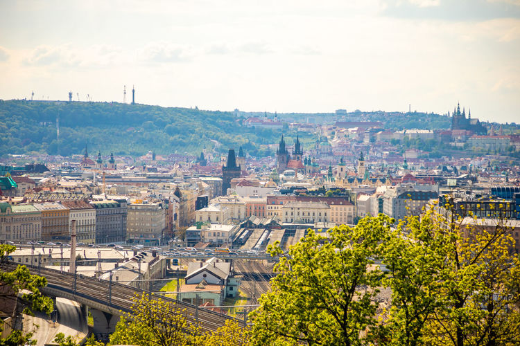 Prague, Czech Republic - 6.05.2019: View from the top of the Vitkov Memorial on the Prague landscape on a sunny day with the famous Zizkov TV tower on the horizon