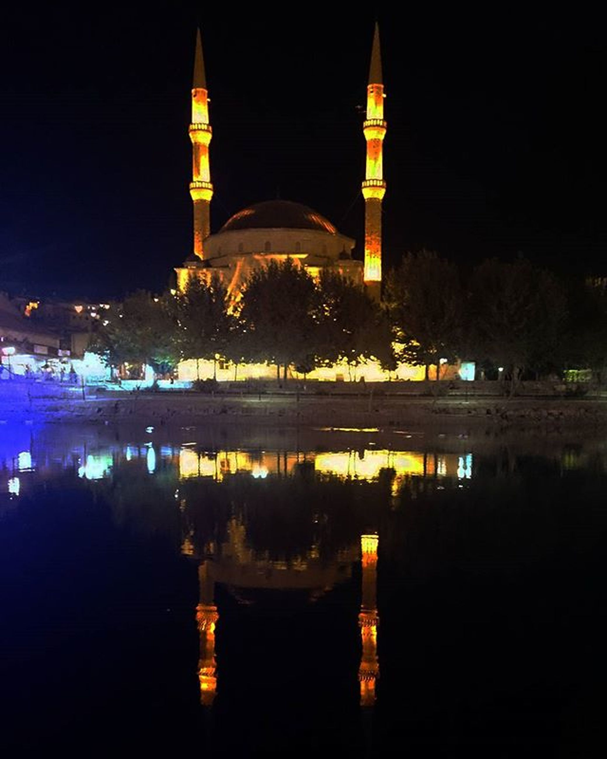 architecture, illuminated, built structure, night, reflection, water, building exterior, place of worship, religion, waterfront, river, spirituality, history, famous place, sky, travel destinations, lake, church, clear sky, dark