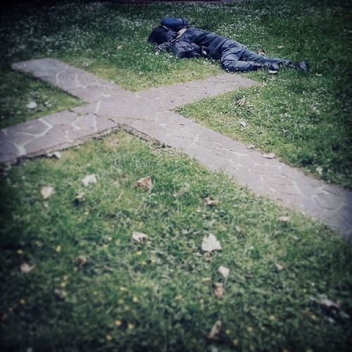 A rough sleeper rests in a church yard. Taken during my Mobile Citizens workshop with @aliroy01 and Kidscompany Mckc14