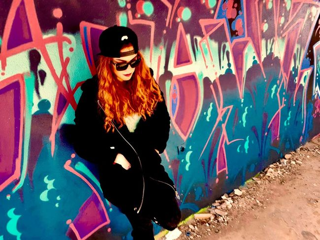 Graffiti N3 . And my lovely model. Graffiti Sunglasses Street Art Standing One Person Fashion EyeEmNewHere Multi Colored Leisure Activity Cool Attitude Portrait Lifestyles Outdoors Adult Young Adult One Woman Only People Day Only Women Young Women One Young Woman Only