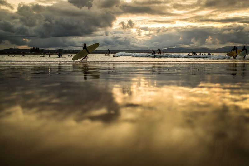 Surfing The Pass at Byron Bay at sundown. Surfer Surfing Byron Bay Australia Cloud - Sky Water Sky Bird Animal Vertebrate Animal Themes Beach Beauty In Nature Reflection Sunset Scenics - Nature Low Tide