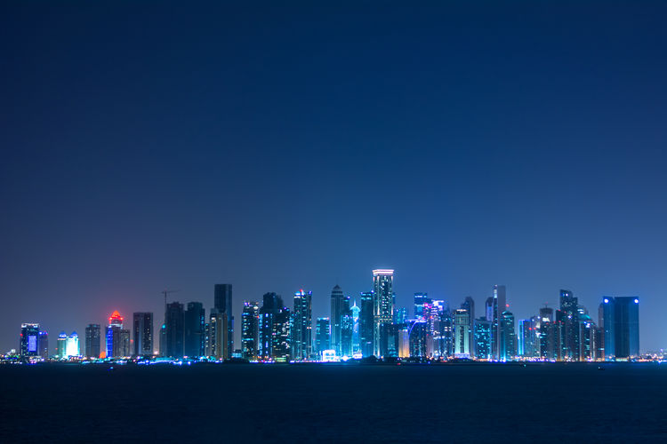 Doha's cityscape as seen from The Pearl peninsula, on a somewhat overcast night. Doha Doha,Qatar Night Lights Nightphotography Skyline Architecture Blue Blue Sky City Cityscape Clear Sky Darkness And Light Illuminated Modern Night Nightlife Nightsky No People Outdoors Scenics Skyscraper Travel Destinations Urban Skyline الدوحة سعودي Fresh On Market 2017