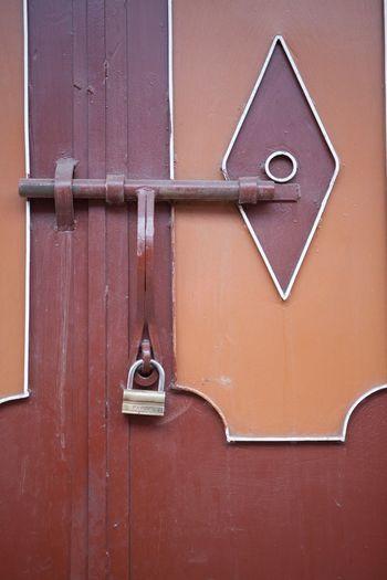 Full Frame Shot Of Locked Red Door