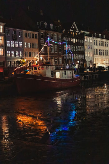 View of boats in river at night