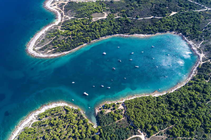 Croatia, Istria, Pula, aerial view of Cape Kamenjak Cape Kamenjak Croatia Drone  Holiday Istra Mediterranean  Rovinj Travel Vacations Adriatic Sea Aerial View Bay Beach Beauty In Nature Boat Dalmatia Istria Kap Kamenjak Lagoon Medulin Premantura Pula Sailing Travel Destinations Turquoise Colored
