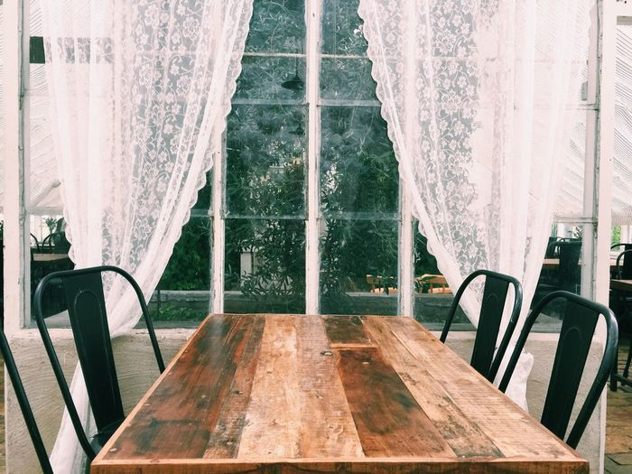 Chairs And Table Against Window At Home
