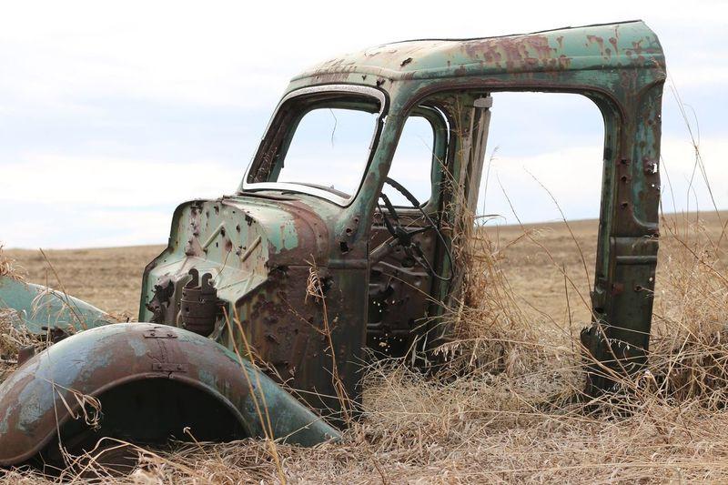 Abandoned Semi-Truck On Field Against Sky