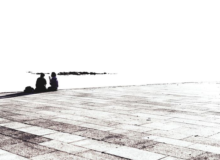 Silhouette men on road