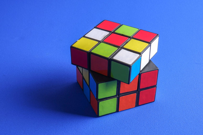 RUBIK'S CUBE , CREATIVITY TOY Creativity Rubik Cube Block Block Shape Blue Blue Background Close-up Colored Background Complexity Copy Space Cube Shape Design Geometric Shape Indoors  Intelligence Multi Colored No People Puzzle  Rubik Shape Still Life Studio Shot Toy Toy Block Wood - Material