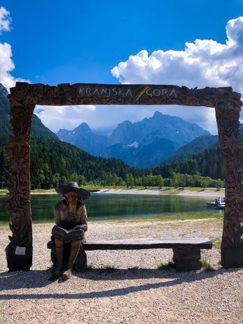 An old man made of wood sitting on a bench Mountains Background Great Outdoors - 2018 Eyeem Awards Emerald Lake Woods Great View Great Outdoors Wooden Sculpure Wood - Material Frame Mountains And Sky Mountains Mountain Lake Slovenia Jasna Lake Jasna Kranjska Gora Sky Mountain Nature Sunlight Day Mountain Range Cloud - Sky Beauty In Nature Scenics - Nature Outdoors Tranquil Scene Landscape The Traveler - 2018 EyeEm Awards