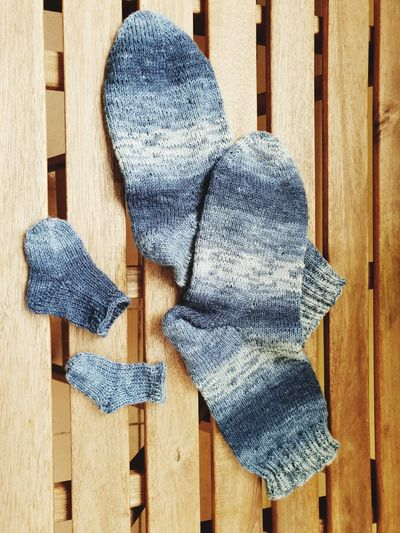 Close-Up Of Socks On Wooden Floor