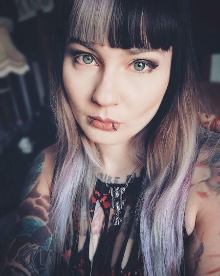 Portrait of beautiful tattooed woman