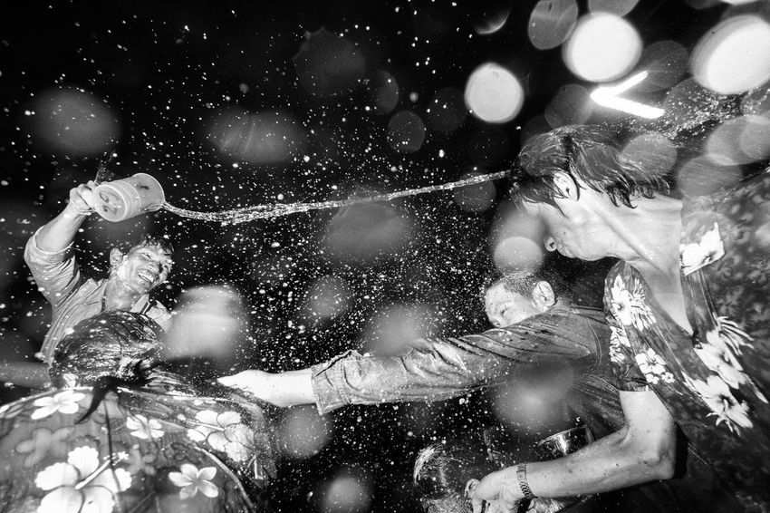Freak Songkran / Songkran is an annual festival in Thailand celebrating the traditional Thai New Year. Water is splashed and poured onto people as a symbol of washing away all of their sins and bad luck. Sometimes, it gets a little freaky. Bangkok Thailand. Water Car Check This Out Blackandwhite Dark Showcase July EyeEm Best Shots Black And White Black & White Streetphoto_bw Streetphotography Streetphoto Photooftheday Streetphotographer Street Photography Thailand Bangkok EyeEm Best Shots - Black + White