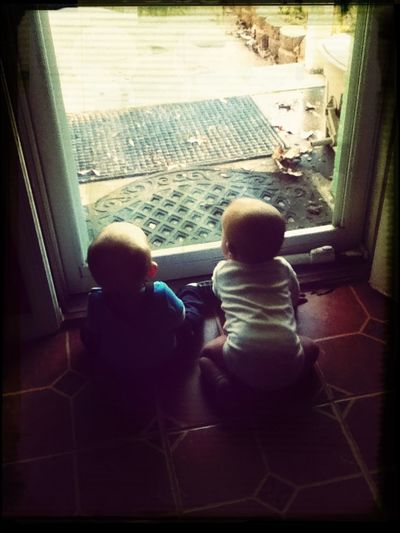 The boys watching the older girls play outside :-)