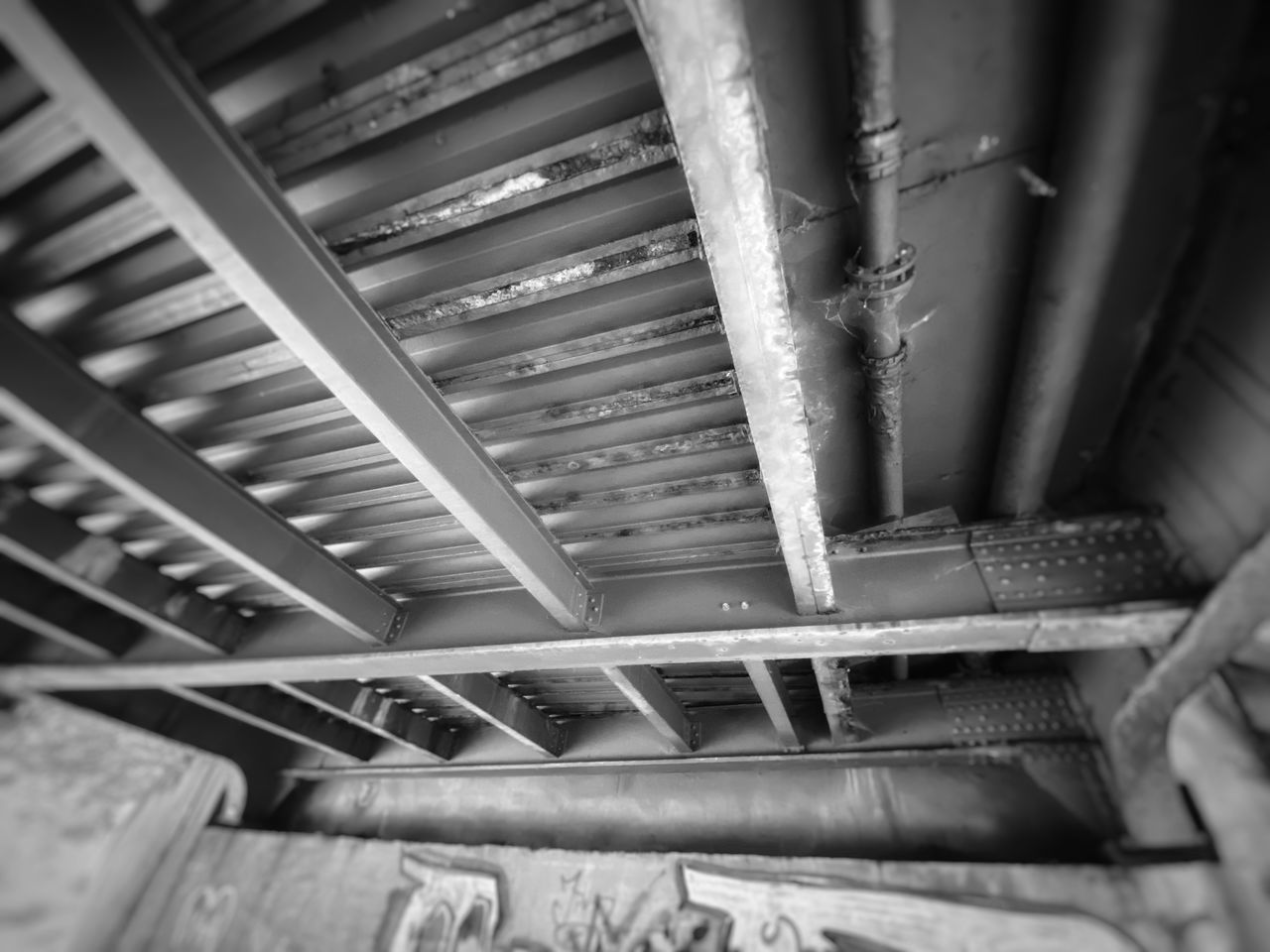 LOW ANGLE VIEW OF CEILING OF STAIRCASE
