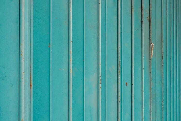Full frame shot of blue metallic wall