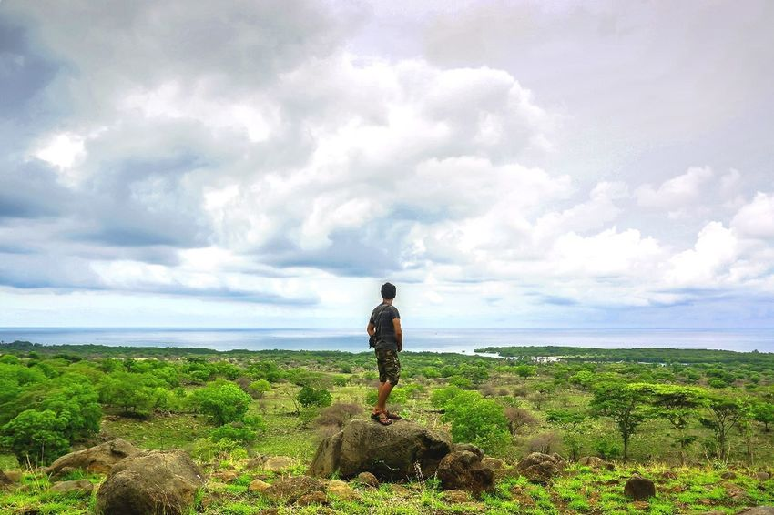 Lost In The Landscape One Person Day Sky Nature Cloud - Sky One Man Only Only Men Men Landscape Sea Agriculture Outdoors Walking Standing Travel People Mountain Nature Balurannationalpark Baluran Beauty In Nature Second Acts
