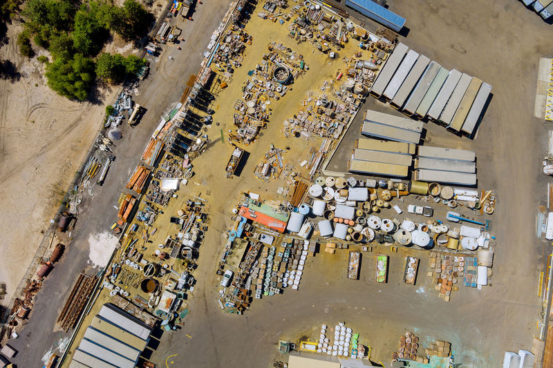 Aerial view industry recycle old machine technician separate classification part of irons metals