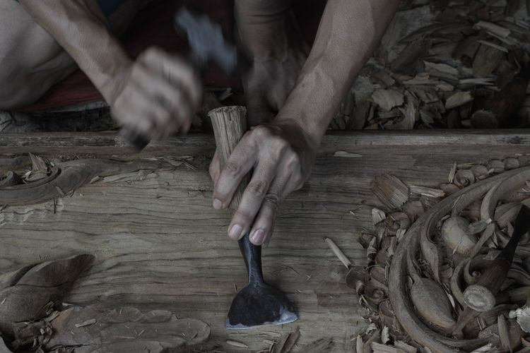 Cropped image of carpenter working in carpentry workshop